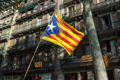 Flag of Catalonia on the Barcelona buildings background Royalty Free Stock Photography