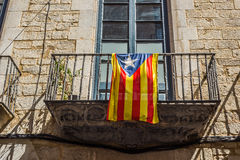 Flag of Catalonia in the downtown of Girona. Spain. Royalty Free Stock Photography