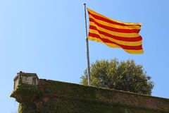 Flag of Catalonia on Montjuic castle, Barcelona, Spain.  royalty free stock image