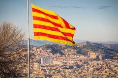 Flag of Catalonia. Sanyor flies over Barcelona.  royalty free stock photo