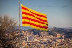 Flag of Catalonia. Sanyor flies over Barcelona.  stock photo