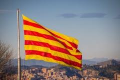 Flag of Catalonia. Sanyor flies over Barcelona.  stock images