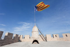 Flag of Catalonia on Serranos Towers Stock Images