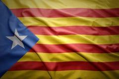 Flag of Catalonia. Waving colorful national Catalonia flag Stock Photo