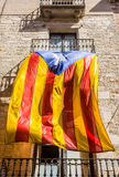 Flag of Catalonia waving in the downtown of Girona. Spain. Royalty Free Stock Photos