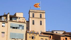 Flag of Catalonia in the wind. The flag of Catalonia is developing in the wind on the roof of an ancient city stock footage