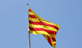 The flag of Catalonia on the wind Stock Photos