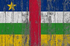 Flag of Central African Republic painted on worn out wooden texture background.  royalty free stock photo