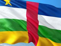 Flag of Central African Republic waving in the wind against deep blue sky. High quality fabric.  royalty free stock photography