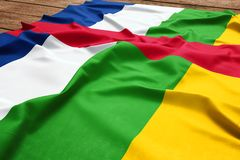 Flag of Central African Republic on a wooden desk background. Silk Central African flag top view.  royalty free stock photo