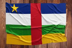 Flag of Central African Republic on a wooden table background. Wrinkled flag top view.  royalty free stock images