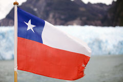 Flag of Chile in Patagonia. Flag of Chile at the San Rafael Glacier, Patagonia Chile. It is one of the major outlet glacier of the Northern Patagonia Ice Field Stock Photos