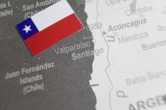 The flag of Chile placed on Santiago map of world map.  stock photos