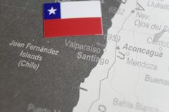 The flag of Chile placed on Santiago map of world map.  stock image