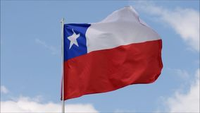 The flag of Chile waves in the wind in slow motion