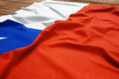 Flag of Chile on a wooden desk background. Silk Chilean flag top view.  royalty free stock photography