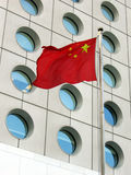 Flag of china. With a business building background Royalty Free Stock Images