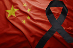 Flag of china with black mourning ribbon. Waving national flag of china with black mourning ribbon Royalty Free Stock Photography