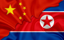 Flag of China and flag of North Korea (Democratic People's Republic of Korea) Royalty Free Stock Photography