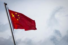 The flag of China is flying in the wind royalty free stock photos
