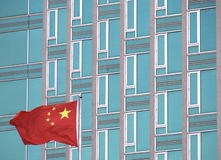 Flag of China with modern office building. Chinese flag with modern office building. The picture was taken in New York in 2014 stock photos