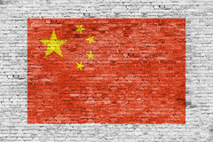 Flag of China painted over brick wall Stock Photo