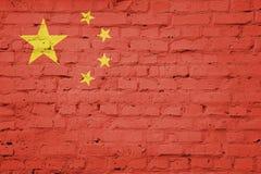 Flag of China. Texture of China flag on a pink brick wall stock illustration