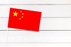 Flag of China on white wooden background top view.  stock photo