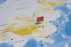 The flag of china in the world map.  stock photos