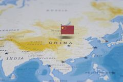 The flag of china in the world map.  stock photography