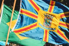 Flag of the city of Campo Grande - MS, Brazil. Flying with the wind and the Brazilian flag on background stock photo