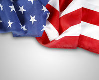 Flag. Closeup of American flag on grey background Royalty Free Stock Photos