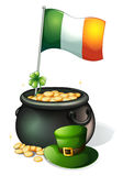 A flag, a clover plant, a pot of gold and a green hat Royalty Free Stock Photos