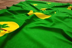 Flag of Cocos Islands on a wooden desk background. Silk flag top view.  royalty free stock photos