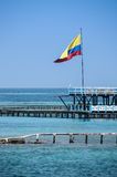 Flag of Colombia over the turqoise Ocean. Cartagena de Indias, South America. Stock Photo