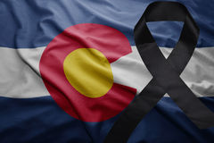 Flag of colorado state with black mourning ribbon. Waving flag of colorado state with black mourning ribbon royalty free stock photos