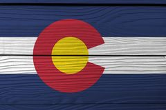 Flag of Colorado on wooden wall background. Grunge Colorado flag texture, The states of America. Flag of Colorado on wooden wall background. Grunge Colorado stock photo