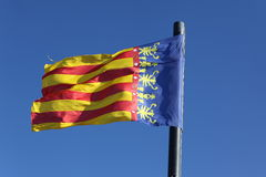 Flag of Comunidad Valenciana, region in Spain, moving in the win Royalty Free Stock Photography