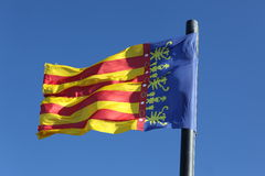 Flag of Comunidad Valenciana, region in Spain, moving in the wind Royalty Free Stock Photography