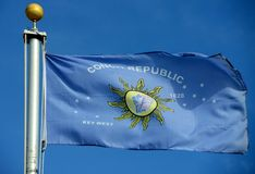 Flag of Conch Republic. In blue sky background. Conch Republic was a nation declared by the city of Key West, Florida in 1982 for tourism purpose Royalty Free Stock Image