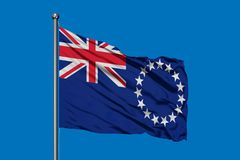 Flag of Cook Islands waving in the wind against deep blue sky royalty free stock photos
