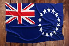 Flag of Cook Islands on a wooden table background. Wrinkled flag top view royalty free stock image