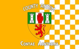 Flag of County Antrim in Ireland. Flag of County Antrim (named after the town of Antrim) is one of six counties that form Northern Ireland, situated in royalty free stock image