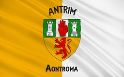 Flag of County Antrim in Ireland. Flag of County Antrim (named after the town of Antrim) is one of six counties that form Northern Ireland, situated in stock photography