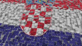 Flag of Croatia being made with jigsaw puzzle pieces. Croatian problem solution conceptual 3D rendering. Flag made of puzzle pieces, conceptual 3D royalty free illustration