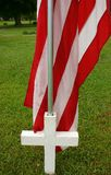 Flag and Cross. Town supports Memorial Day by puting up cross with Flag stock image