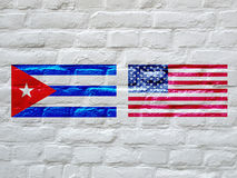 Flag of Cuba and USA. Flag of the USA and Cuba on a white bricks wall Stock Photography