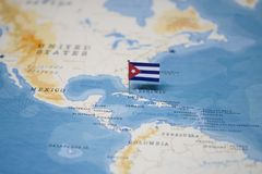 The Flag of cuba in the world map.  stock image