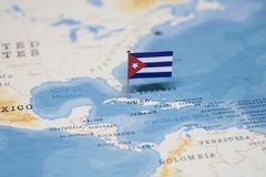 The Flag of cuba in the world map.  royalty free stock photo