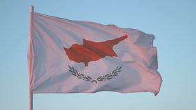 Flag of Cyprus flapping in wind, national symbol against blue sky, loopable shot. Stock footage stock footage